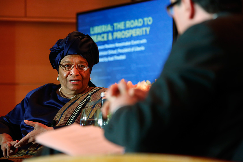 Liberian President Ellen Johnson Sirleaf speaks with Axel Threlfall from Reuters