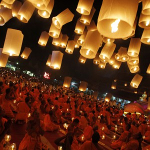 Buddhist monks release paper lanterns into the sky in Suphan Buri province