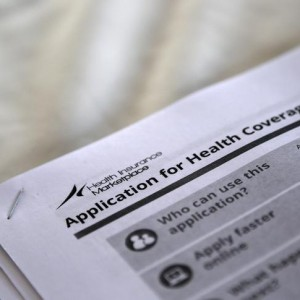 Applications are seen at a rally held by supporters of the Affordable Care Act in Jackson, Mississippi