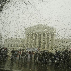 The Supreme Court is seen from within a car as snow melts on the window during a light snow falling in the first week of Spring in Washington