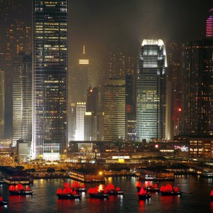 Illuminated boats float on Hong Kong's Victoria Harbour during the opening ceremony of the East Asian Games