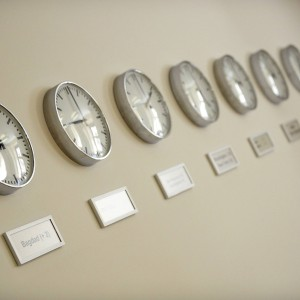 Clocks are pictured on the wall of the crisis committee centre at the Foreign Ministry in Berlin