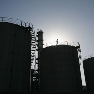 An engineer conducts routine checks on oil tanks at a refinery in Wuhan