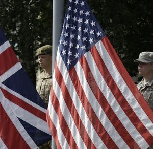 "Soldiers stand next to U.S. and British flags during the opening ceremony of NATO military exercise ""Saber Strike"" in Adazi"