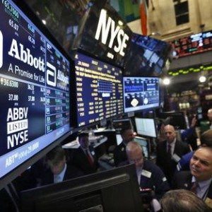 Traders gather at the booth that trades Abbott Laboratories on the floor of the New York Stock Exchange