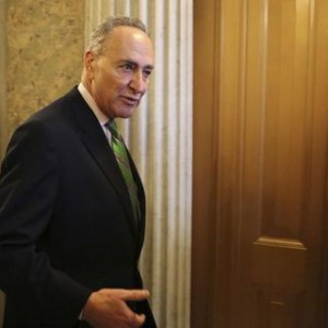 U.S. Senator Schumer leaves after a Senate cloture vote on budget bill on Capitol Hill in Washington