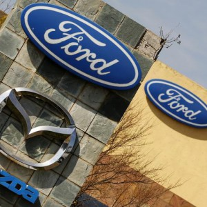 The logos of Ford and Mazda Motor Co are seen at the company's assembly plant in Pretoria