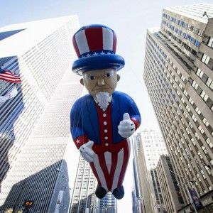 An Uncle Sam balloon floats down Sixth Avenue during the 87th Macy's Thanksgiving Day Parade in New York