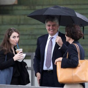 Former UBS banker Raoul Weil, accompanied by his wife Susan Lerch Weil, arrives at federal court in Fort Lauderdale