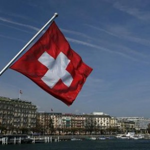 A Swiss flag is pictured on the Mont-Blanc bridge over Lake Leman in Geneva