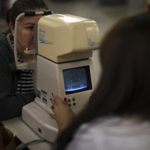 A woman receives a glaucoma test during Care Harbor LA free medical clinic in Los Angeles