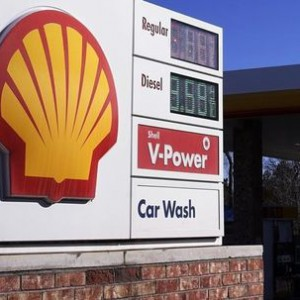 The Shell logo sign is seen at one of its gas station next to the current fuel prices display in Westminster, Colorado
