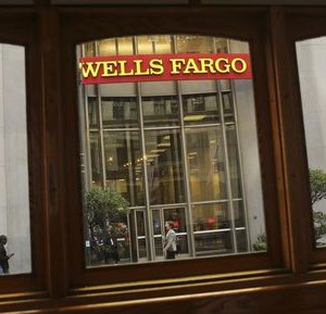 A Wells Fargo Bank sign is seen through a motorized cable car in San Francisco