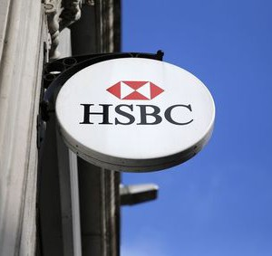 An HSBC sign is seen outside a bank branch in London