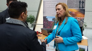 Suzanne Hopkins speaks with an attendee at the World Bank Land & Poverty Conference Innovation Fair.