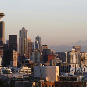 The Space Needle and Mount Rainier are pictured at dusk in Seattle, Washington