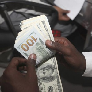 A teller counts U.S. notes at the Dahabshill money transfer office in capital Mogadishu