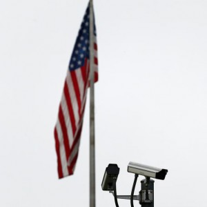 CCTV cameras are pictured on the fence of The United States Mission to the United Nations in Geneva