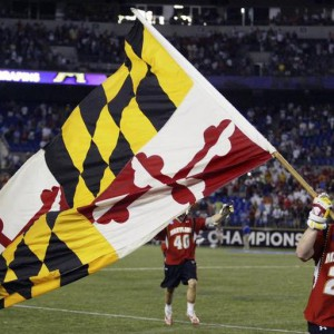 Mark White of the University of Maryland runs on the field with the Maryland State Flag after Maryland defeated Duke University in their NCAA Division I Men's Lacrosse semi-final game in Baltimore, Maryland May 28, 2011. Maryland will play the University of Virginia in the championship game on Monday.  REUTERS/Joe Giza (UNITED STATES - Tags: SPORT)