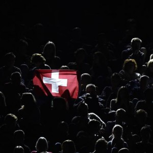 A fan holds a Swiss flag during the semi-final tennis match between Stan Wawrinka of Switzerland and Roger Federer of Switzerland at the ATP World Tour Finals at the O2 Arena in London November 15, 2014. REUTERS/Toby Melville (BRITAIN - Tags: SPORT TENNIS)
