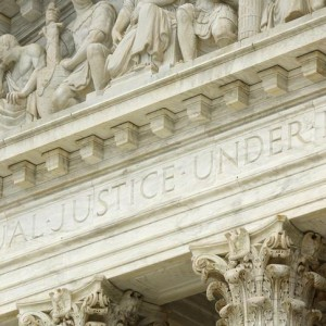 "The phrase ""Equal Justice Under Law"" adorns the west entrance to the U.S. Supreme Court building in Washington December 3, 2014.  Picture taken December 3, 2014. To match Special Report SCOTUS-ELITES/  REUTERS/Jonathan Ernst    (UNITED STATES - Tags: POLITICS LAW BUSINESS)"