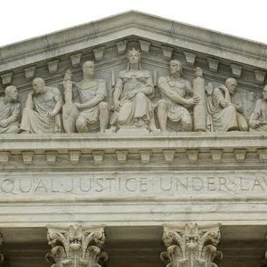 "The phrase ""Equal Justice Under Law"" adorns the west entrance to the U.S. Supreme Court building in Washington December 3, 2014.  Picture taken December 3, 2014. To match Special Report SCOTUS-ELITES/  REUTERS/Jonathan Ernst"