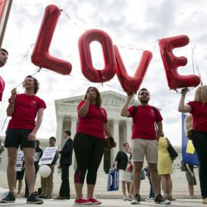 Supporters of gay marriage rally in front of the Supreme Court in Washington June 25, 2015. A decision in Obergefell v. Hodges, a test of a constitutional right to same-sex marriage, is expected in the coming days.   REUTERS/Joshua Roberts - RTR4YXU1