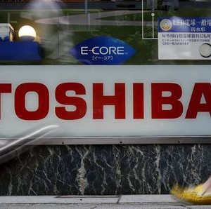 Pedestrians walk past a logo of Toshiba Corp outside an electronics retailer in Tokyo, Japan, June 25, 2015. REUTERS/Yuya Shino -