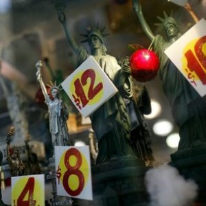 Prices are seen on replica Statues of Liberty figures in a shop window in New York City, in this November 14, 2011 file photo. REUTERS/Mike Segar