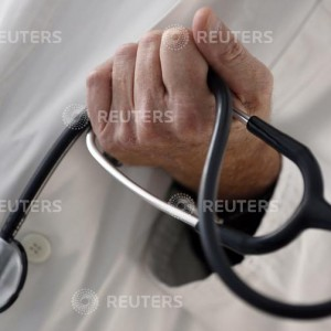 A photo illustration shows a French general practitioner holding a stethoscope in a doctor's office in Bordeaux January 7, 2015. French physicians protest against a new health reform bill that would introduce a third party payment system. Picture taken January 7, 2015.   REUTERS/Regis Duvignau (FRANCE - Tags: HEALTH POLITICS)