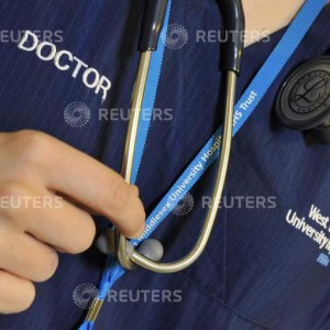 "A doctor holds her stethoscope in an outpatients ward at a hospital in west London April 4, 2011. Labour leader Ed Miliband described coalition plans to reform the NHS as ""chaotic"" on Monday and warned they would make hospital closures more likely.   REUTERS/Toby Melville (BRITAIN - Tags: HEALTH POLITICS)"
