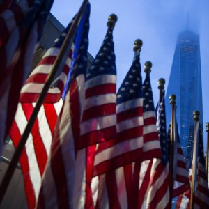 One World Trade Center is seen behind U.S flags on the morning of the 14th anniversary of the 9/11 attacks, in Lower Manhattan in New York September 11, 2015. Relatives of the nearly 3,000 people killed in the Sept. 11, 2001, attacks are due to gather in New York, Pennsylvania and outside Washington on Friday to mark the 14th anniversary of the hijacked airliner strikes carried out by al Qaeda militants. REUTERS/Andrew Kelly