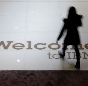 A woman walks over a welcoming sign at the booth of IBM at the CeBIT trade fair in Hanover March 15, 2015. The world's biggest computer and software fair will open to the public from March 16 to 20.  REUTERS/Morris Mac Matzen