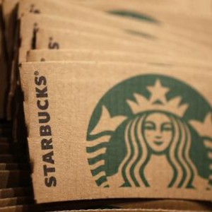 Branded packaging is seen in Starbucks' Vigo Street branch in Mayfair, central London January 11, 2013.  REUTERS/Stefan Wermuth (BRITAIN - Tags: BUSINESS LOGO FOOD) - RTR3CBWV