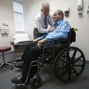 Doctor Stephen Hippler treats patient Don Roth at his office in Peoria, Illinois, November 26, 2013. Now, patients are at the forefront of an experiment, under way in Peoria, Illinois, and hundreds of other U.S. cities, that could transform the way doctors, nurses and hospitals deliver care to patients. Amid the barrage of criticism over the rollout of Obamacare, groups known as Accountable Care Organizations (ACOs) are quietly going about the business of testing the potential for healthcare reform. The efforts, born of President Barack Obama's Affordable Care Act, are part of the biggest experiment yet to fix the costly and error-plagued U.S. healthcare system. The new models of care, which encourage providers to form networks to coordinate care and cut costs, involve close monitoring of the sickest patients to address budding health problems before they cause a costly trip to the emergency room or an extended hospital stay. To match Feature USA-HEALTHCARE/PEORIA Picture taken November 26, 2013. REUTERS/Jim Young  (UNITED STATES - Tags: HEALTH POLITICS)