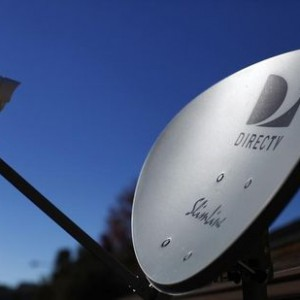 A DirecTV satellite dish is seen on a residential home in Encinitas, California November 5, 2014. Satellite TV provider DirecTV will report its third-quarter earnings Thursday.    REUTERS/Mike Blake