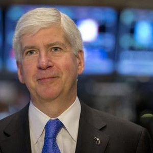 Michigan Governor Rick Snyder gives an interview on the floor of the New York Stock Exchange May 8, 2015. REUTERS/Brendan McDermid