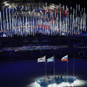 The South Korean (L), Russian (R) and Greek national flags are seen raised during the closing ceremony for the 2014 Sochi Winter Olympics, February 23, 2014.              REUTERS/Issei Kato (RUSSIA  - Tags: OLYMPICS SPORT TPX IMAGES OF THE DAY)