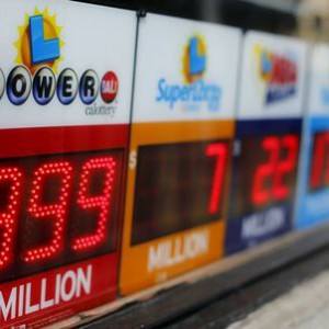 A Powerball sign shows $999 million outside a corner corner store in San Diego, California January 13, 2016. The jackpot in the Powerball lottery, already the largest ever payout in North American history, continued to climb, hitting an estimated 1.5 billion dollars. REUTERS/Mike Blake