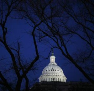 The U.S. Capitol building is seen before the start of President Barack Obama's primetime address to a joint session of the U.S. Senate and House of Representatives on Capitol Hill in Washington February 24, 2009.   REUTERS/Jim Young   (