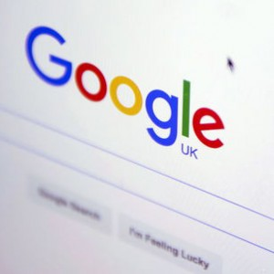 "The Google internet homepage is displayed on a product at a store in London, Britain January 23, 2016. Google has agreed to pay 130 million pounds ($185 million) in back taxes to Britain, prompting criticism from opposition lawmakers and campaigners who said the ""derisory"" figure smacked of a ""sweetheart deal"".    REUTERS/Neil Hall -"