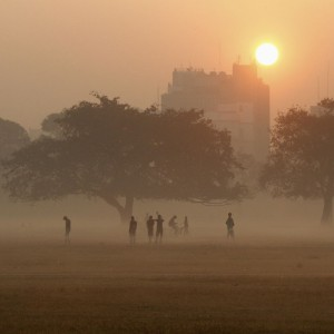 Joggers stand amid fog as sun rises in Kolkata, India. February 20, 2013.