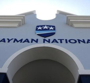 The logo of the Cayman National Bank is pictured on a branch in George Town, Cayman Islands, April 26, 2010.   REUTERS/Gary Hershorn