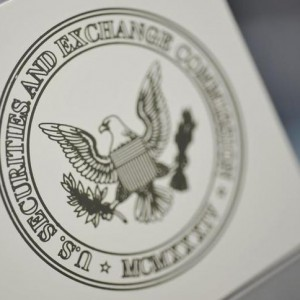 The U.S. Securities and Exchange Commission logo adorns an office door at the SEC headquarters in Washington, June 24, 2011. The database is emerging alongside a new program by the FBI's criminal profiling group in Quantico, Virginia, that is creating a series of behavioral composites to help agents investigate white collar crime. The more systematic approach by the SEC and FBI comes in response to the growth and complexity of financial crimes in recent years. Picture taken June 24, 2011. To match Special Report SEC/INVESTIGATIONS  REUTERS/Jonathan Ernst    (UNITED STATES - Tags: CRIME LAW POLITICS BUSINESS)