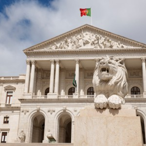 The Palácio de São Bento - the Portuguese Parliament -close to Bairro Alto in Lisbon, Portugal - is guarded by a stone lion