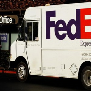 A Federal Express truck loads packages at one of the company's FedEx Office outlets in Encinitas, California January 16, 2011.  REUTERS/Mike Blake