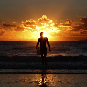 A man leaves the water after swimming at Sydney's Coogee beach at sunrise February 14, 2013. REUTERS/Daniel Munoz