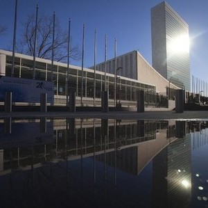 The United Nations building is reflected in a puddle in the Manhattan borough of New York February 18, 2015.      REUTERS/Carlo Allegri
