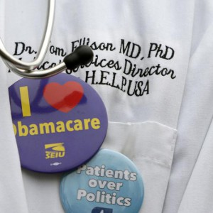 Dr. Tom Ellison of Birmingham, Alabama wears a stethoscope and pro-affordable healthcare buttons, during a demonstration in front of the Supreme Court in Washington March 4, 2015. The U.S. Supreme Court will weigh a second major case, King v. Burwell, targeting President Barack Obama's healthcare law on Wednesday when it considers a conservative challenge to tax subsidies critical to the measure's implementation.       REUTERS/Gary Cameron     (UNITED STATES - Tags: POLITICS HEALTH)