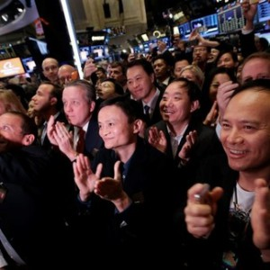 "Alibaba Group Holding Ltd founder Jack Ma (C) applauds at the New York Stock Exchange before his company's initial public offering (IPO) under the ticker ""BABA"" in New York September 19, 2014.  REUTERS/Brendan McDermid"